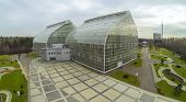 MOSCOW - OCT 23: View from unmanned quadrocopter to futuristic glass building of Main Greenhouse Bot