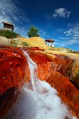 Red soil around Analavory geysers at sunny day. Madagascar