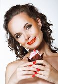 Gourmet. Happy Young Woman Holding Cupcake With Whipped Cream