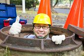 Sewerage Worker In The Manhole With Thumb Up