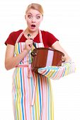picture of ladle  - Surprised shocked emotional housewife or chef in colorful kitchen apron with pot of soup and ladle isolated studio shot - JPG