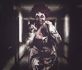 Creepy Medical Clown In Grunge Hospital Hallway