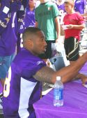 Minnesota Viking Linebacker David Herron signs autographs.