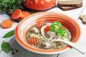 stock photo of meatballs  - Meatball soup and buckwheat in a bowl on the table - JPG