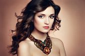 Portrait Of Beautiful Brunette Woman With Earring. Perfect Makeup