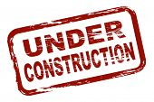 An illustrated red stamp that shows the term under construction. All on white background.