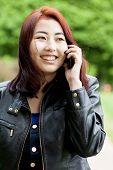 Mongolian Girl Talking On Phone