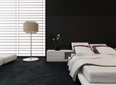 Modern bedroom interior with black and white decor with an adjustable bed and freestanding standard lamp with huge windows covered with blinds