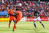 Sisaket Thailand-may 28: Chatchai Mokkasem Of Sisaket Fc. (no.2, Orange) Clear The Ball During Thai