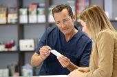 Pharmacist giving information on medicine