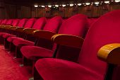 foto of cinema auditorium  - Empty red seats for cinema theater conference or concert - JPG