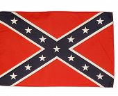 Closeup of Confederate flag on plain background