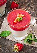 Dessert Panna Cotta with fresh strawberry on old wooden background