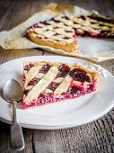 image of cherry pie  - Open Cherry Pie On The Wooden Background - JPG