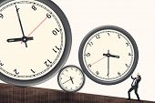 Time pressure concept, Asian business man face the rolling clock.