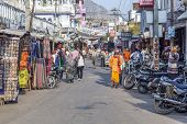 People Walk Around Pushkar In The Main Street