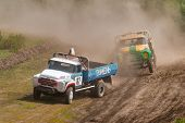 Sport trucks racing on unpaved track