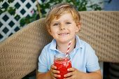Little Blond Boy Drinking Healthy Watermelon Juice In Summer.