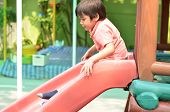 Little Boy Sliding Outdoor Play Time