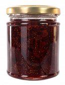 Wild strawberries preserved in glass jar