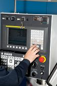 image of heavy equipment operator  - Man hand the controls of a machine CNC - JPG
