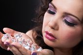 Young Woman Holding Diamonds