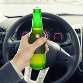 Man Holding Bottle Of Beer While Driving - 1 To 1 Ratio