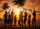 stock photo of break-dance  - Group of Cheerful People Partying on a Beach - JPG