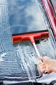 Hand Washing Car Window With Mop