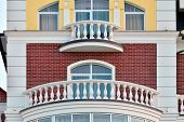 foto of balustrade  - White balconies with balustrades of a new home - JPG