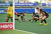 THE HAGUE, NETHERLANDS - JUNE 2: Belgian Defenders duck away when Dorst (NED) attempts a shot at goal after a penalty corner during the World Cup Hockey match between Netherlands and Belgium (4-0)