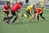 THE HAGUE, NETHERLANDS - JUNE 2: Glenn Turner (AUS) rushes through three Spanish defenders with the