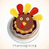 Thanksgiving Day celebration with turkey cupcake and stylish text  Thanksgiving on shiny background.