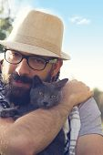 Hipster Guy Playing With His Cat
