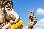 Close-up Statute Of Ganesha Outdoor Against Blue Sky And White Clouds