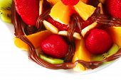 foto of crown green bowls  - exotic fruits in chocolate cream on white bowl - JPG