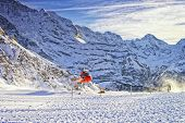 Red Helicopter Take Off  At Swiss Ski Resort Near Jungfrau Mountain
