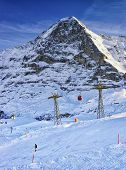 Snowboarder On The Slope At Winter Sport Resort In Swiss Alps