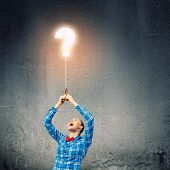 Young woman in casual holding balloon. Question concept