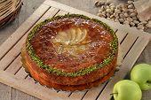 Apple cake on rustic ambient.