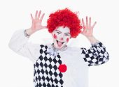 Little Girl In Red Wig Posing As A Clown.