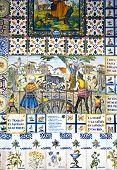 Decorative tiles on Madrid street. National decorative art with agricultural symbols