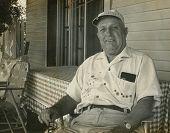 CANADA - CIRCA 1950s: Vintage photo shows elderly man in his home.