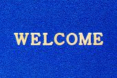 Texture Of Blue Doormat With Welcome Text