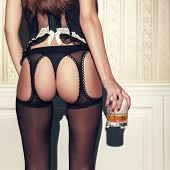Sensual Woman Holding Glass Of Whiskey Vintage Style