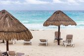 Sun Umbrella And Beds On Caribbean Beach In Cloudy Weather