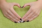 stock photo of nail paint  - Finger nail treatment hands with painted fingernails making heart sign - JPG
