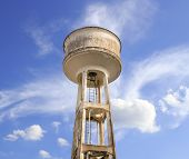 Water Tower Painted White Under Blue Sky