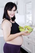 Beautiful Healthy Mother With Salad