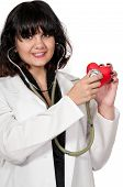 image of open heart surgery  - Beautiful young woman cardiologist doctor holding a heart - JPG